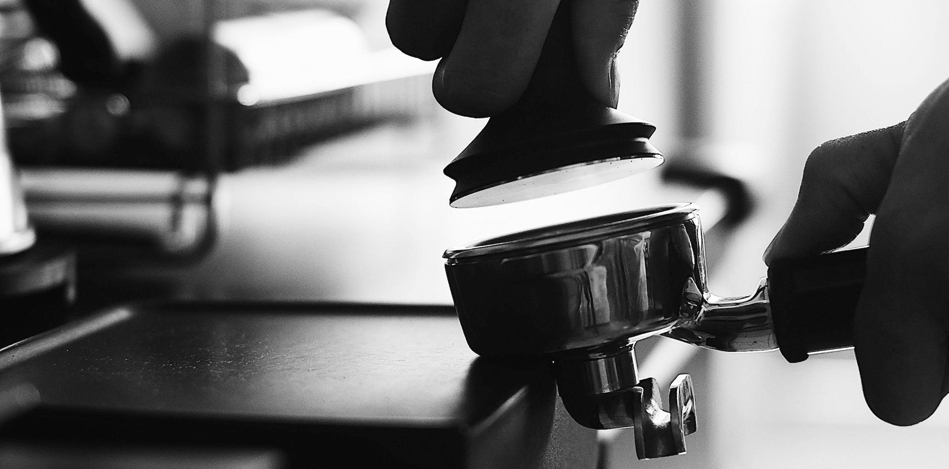 barista pressing coffee