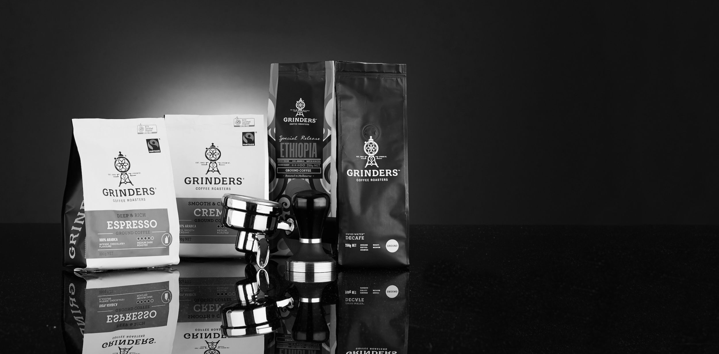 Grinders Coffee ground coffee packs in black and white 2