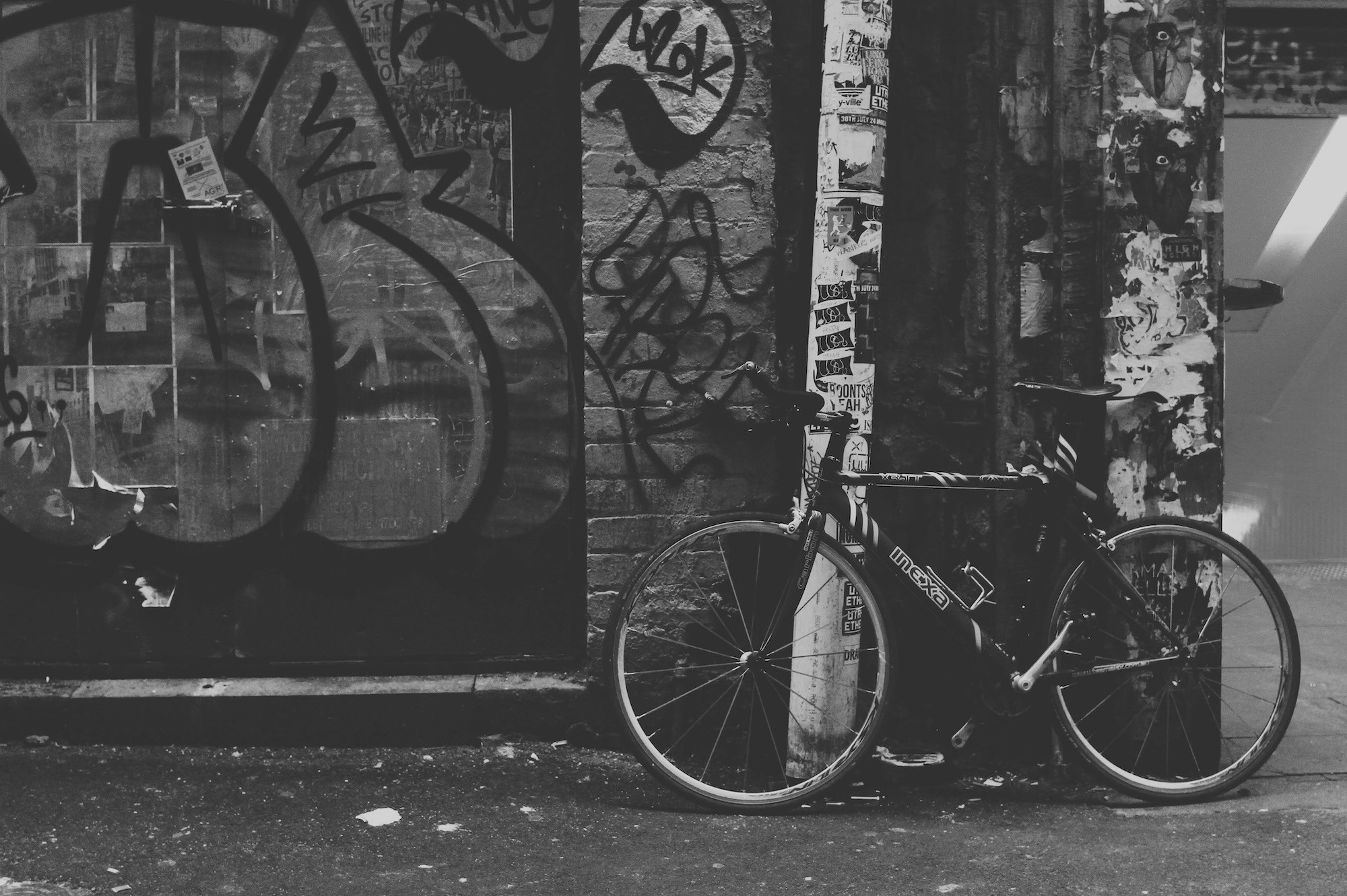 Bicycle next to graffiti wall
