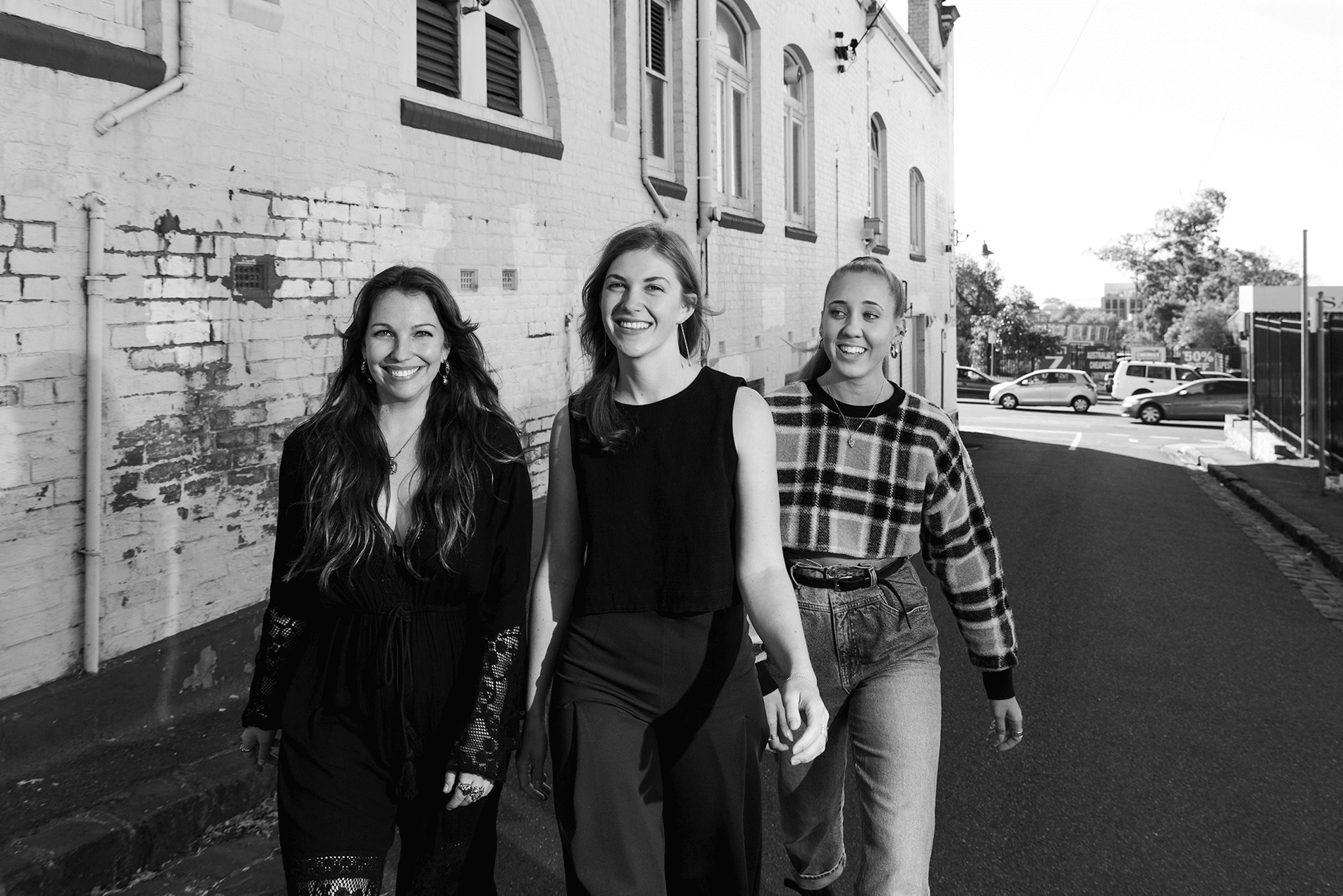 Antra, Megan and Janeva walking together